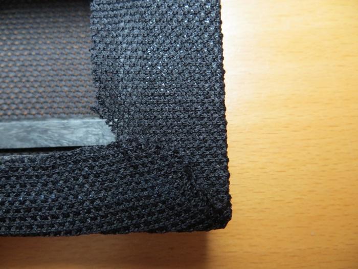 Vervangen luidsprekerdoek: verwijder overtollig luidsprekerdoek