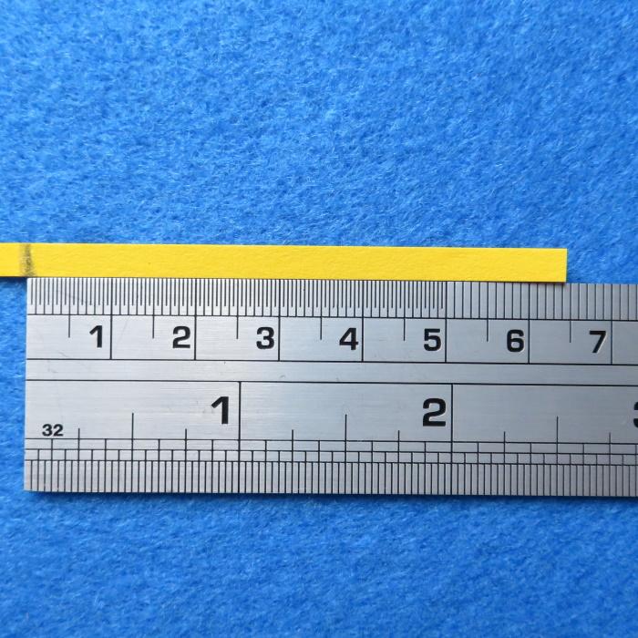 Luidspreker stofkap vervangen - gebruik een stukje papier op de maat van de stofkap te bepalen